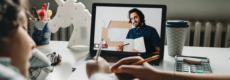 laptop showing online teacher teaching