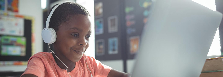 boy with headphones with laptop