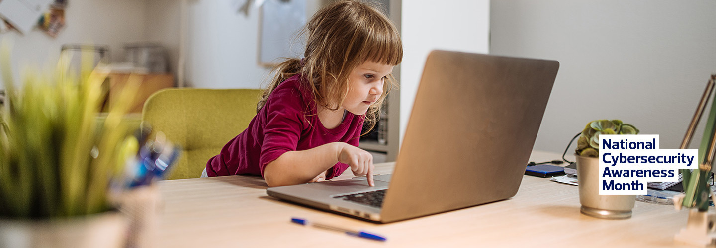 young girl using internet on parent's laptop
