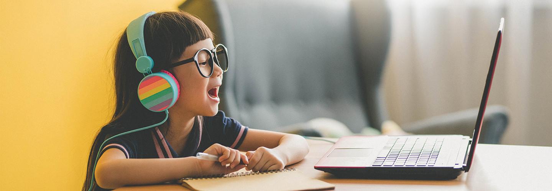 Girl using laptop for online learning