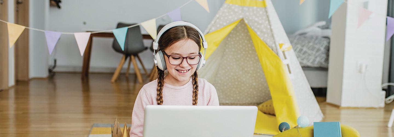 Girl using laptop for online school
