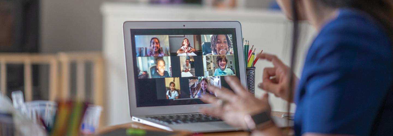 teacher teaching remotely with laptop