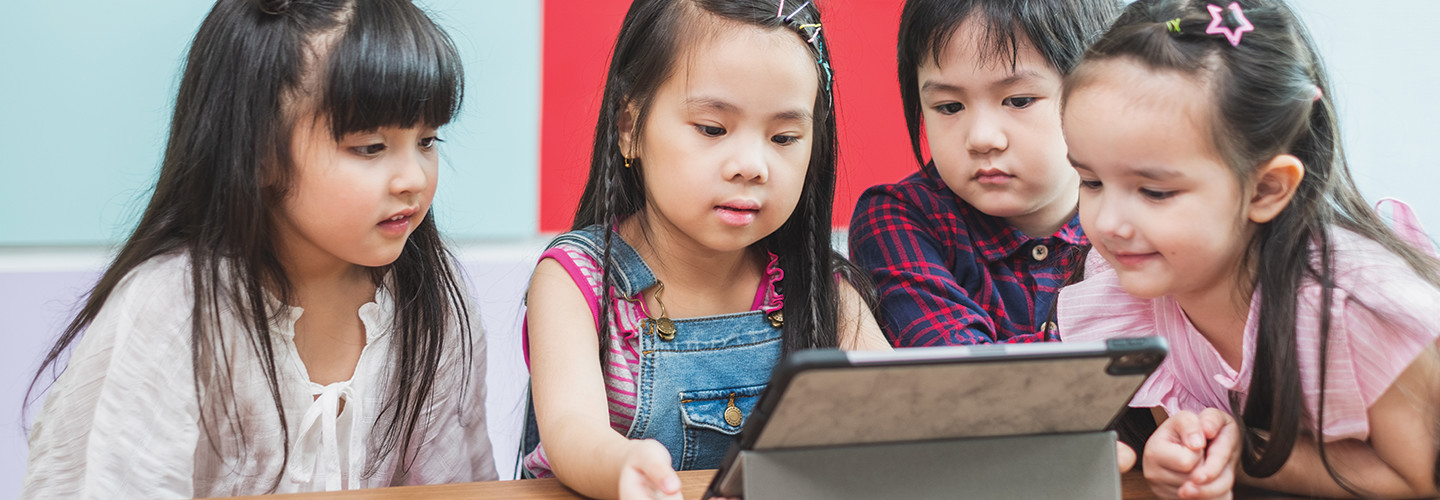 Group of kids remote learning on tablet