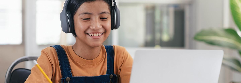 Student on laptop with headphones