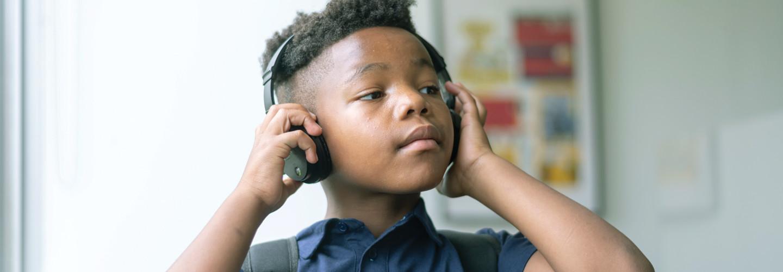 K–12 student with headphones EdTech Essentials