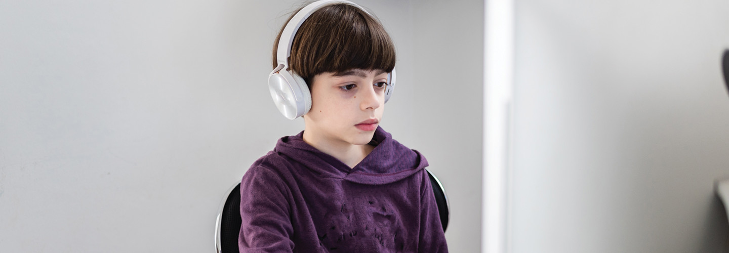Student remote learning with headset and computer