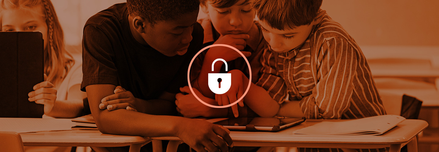 Students at desk behind image of lock - cybersecurity