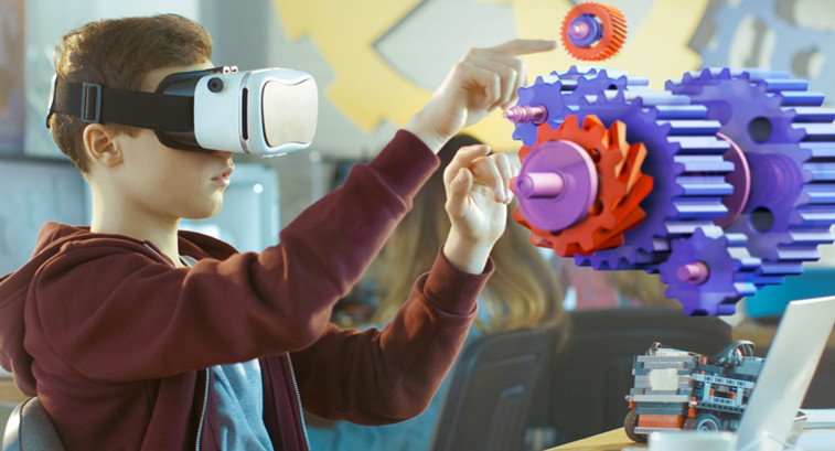 Student uses augmented reality platforms and vr education apps to learn coding.