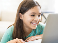 young girl on laptop smiling