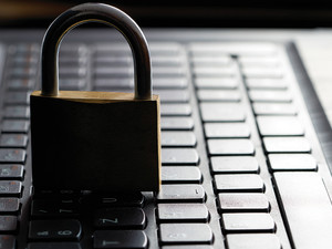 padlock on laptop keyboard